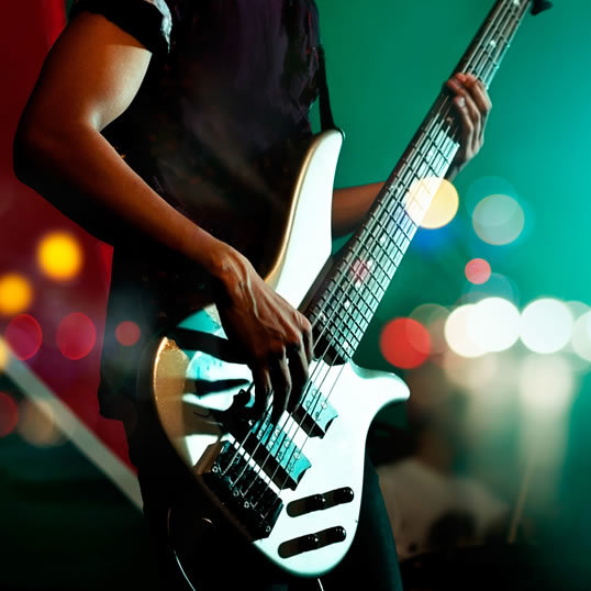 guitarist-bass-on-stage-background-colorfu
